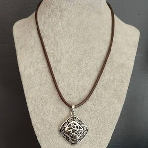 Silver and black pendant necklace on cording